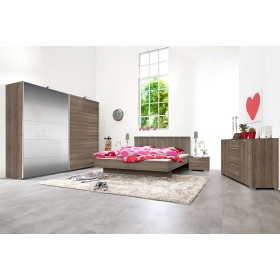 Inline free-standing wardrobe with dark oak melamine and mirror panels.